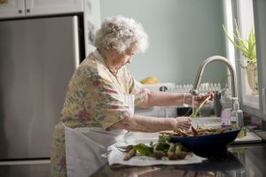 -elderly-woman-washing-produce-pv